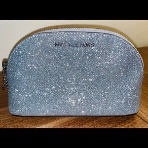Never been used, sparkle, make up bag!